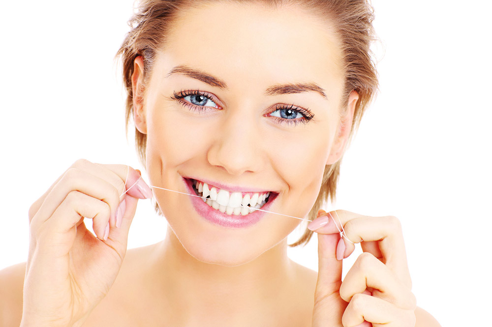 Hilo dental con invisalign